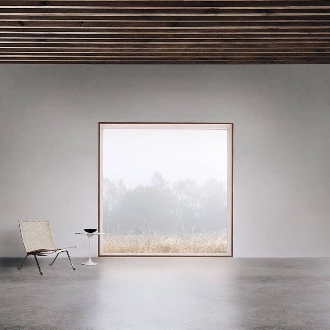 Empty room with concrete floor, wooden ceiling and large window