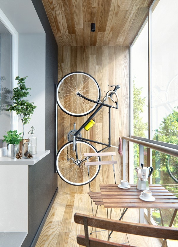 Bike stored vertically indoors, on wooden wall by window
