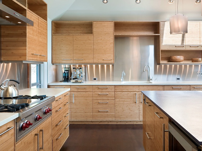 'Warm' wooden kitchen cabinetry with 'cool' stainless steel accents