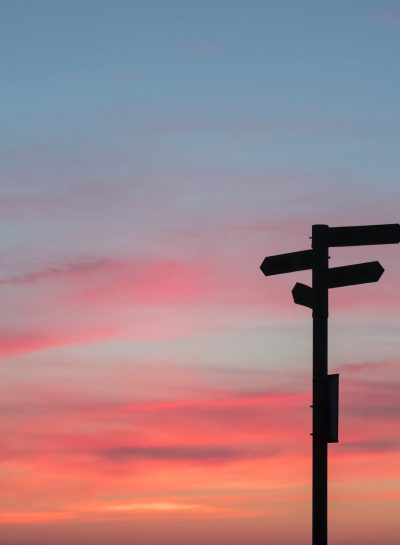 signpost at sunset_ stuck_ decision making